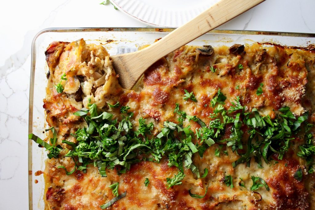 Italian Turkey Spaghetti Squash Casserole sitting in a pan on a counter top with a spoon