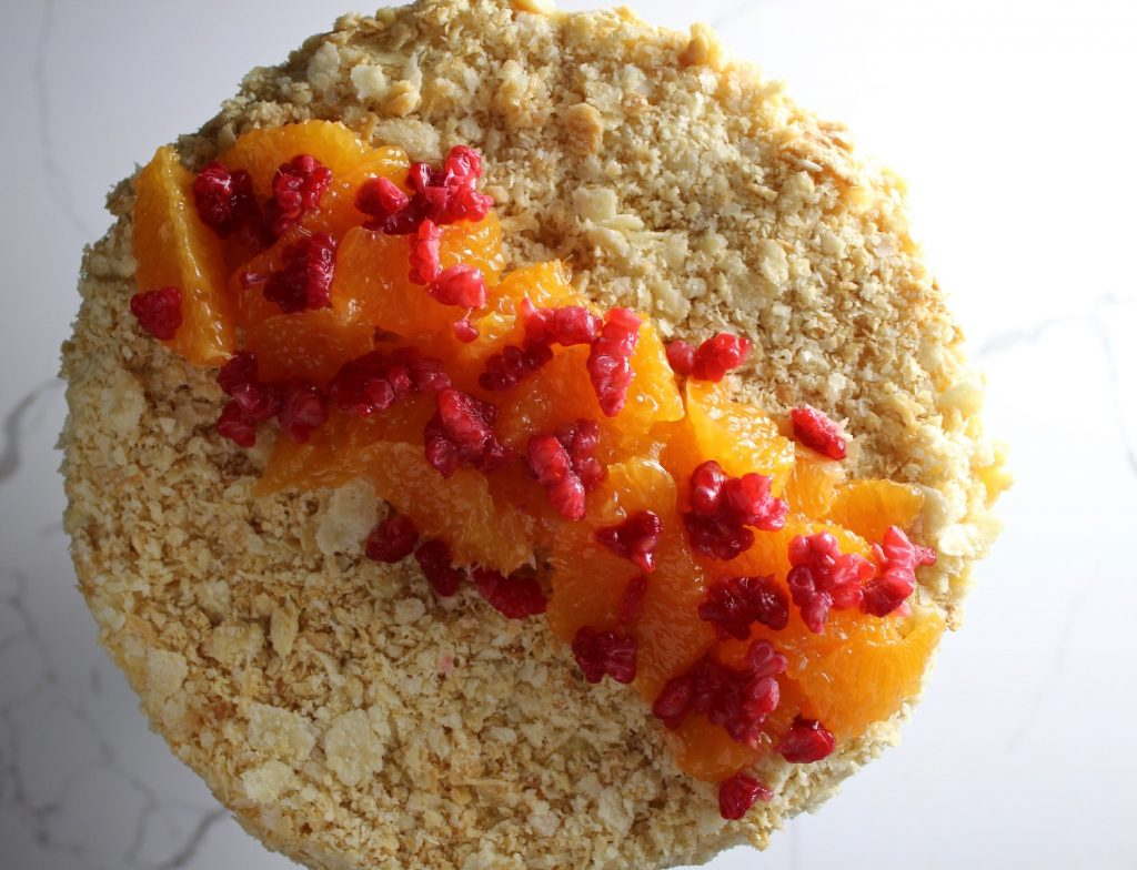 Top down picture of Russian Napoleon Cake with oranges and raspberries