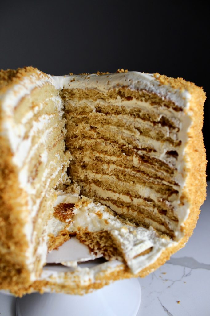 An inside view of Russian Honey cake, viewing the layers of cake and cream frosting