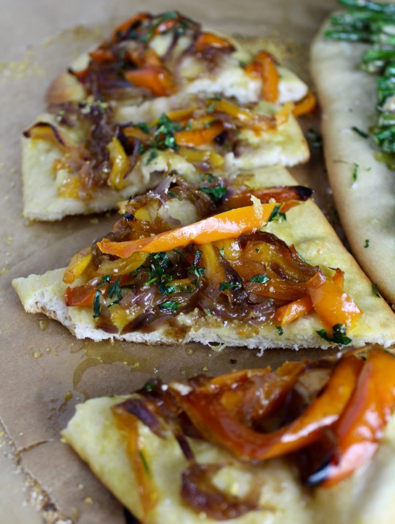 sliced up catalan flatbread on brown parchment paper