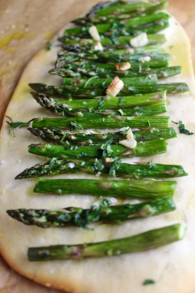 Close up shot of asparagus on a catalan flatbread