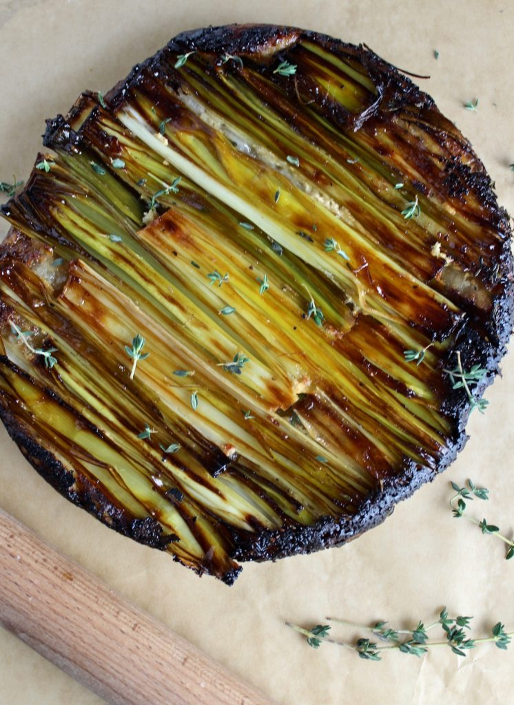top down view of caramelized leek tart on parchment paper