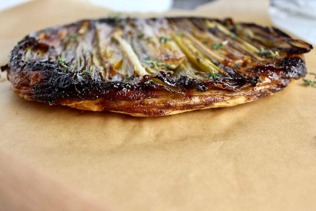 side view of caramelized leek tart