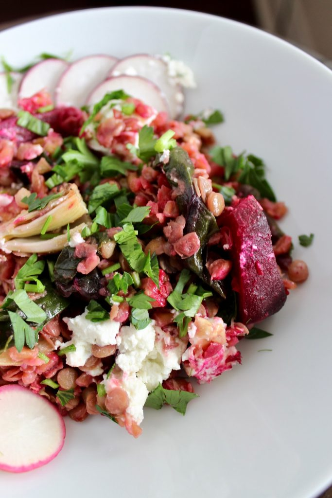 Side view of French Lentil Salad with Beets and Fennel in a small bowl