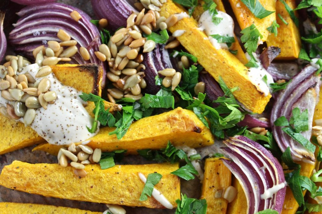 close up shot of Butternut Squash with Tahini and Za'atar on a pan